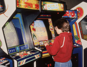 Boy playing video arcade games
