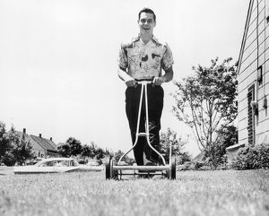 Man happily mowing lawn